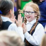 school girls playing clapping games