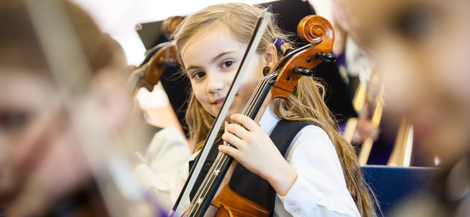 school girl playing cello