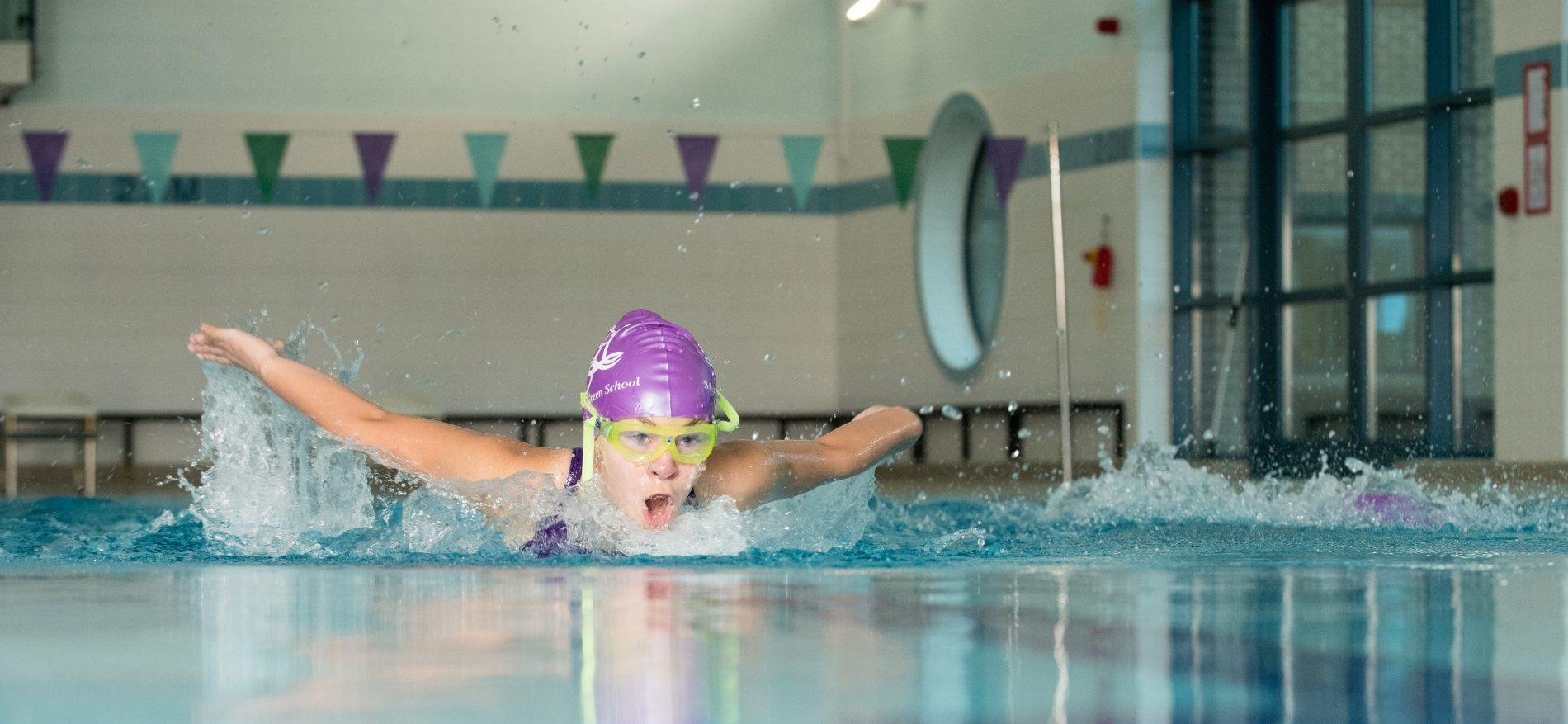 school girl swimming
