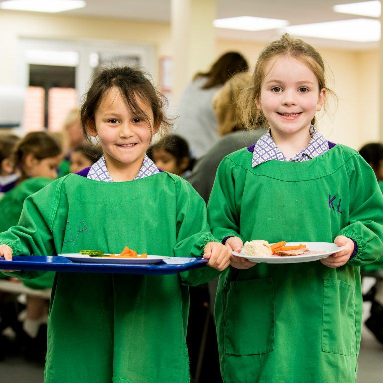 two girls with school dinners