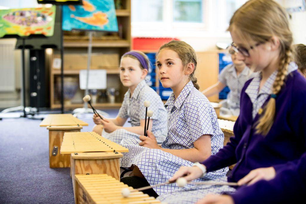 school girls in music lesson