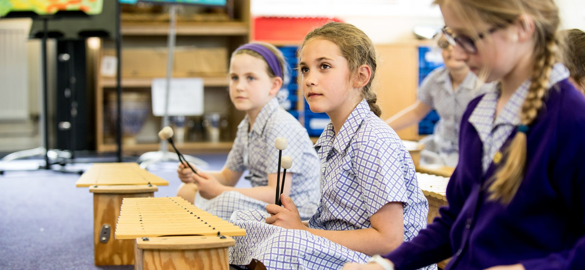 school girls in music lesson