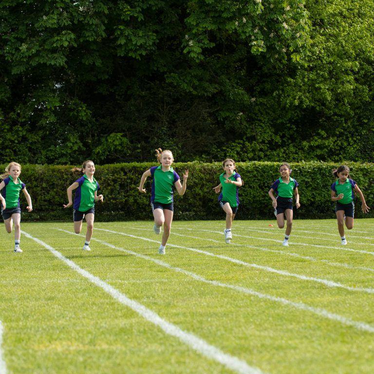 school girls racing on sports day