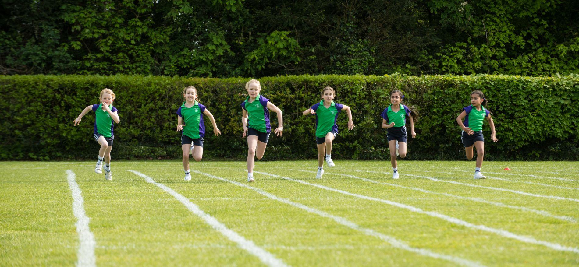 school girls having sports day