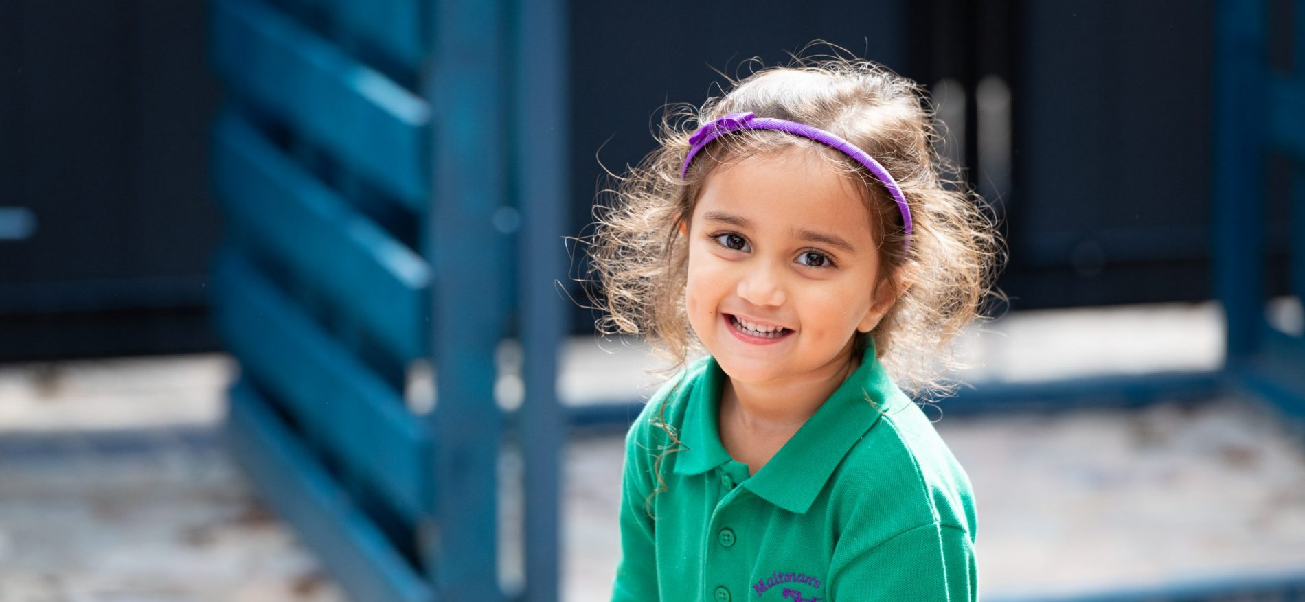 A smiling child in the playground